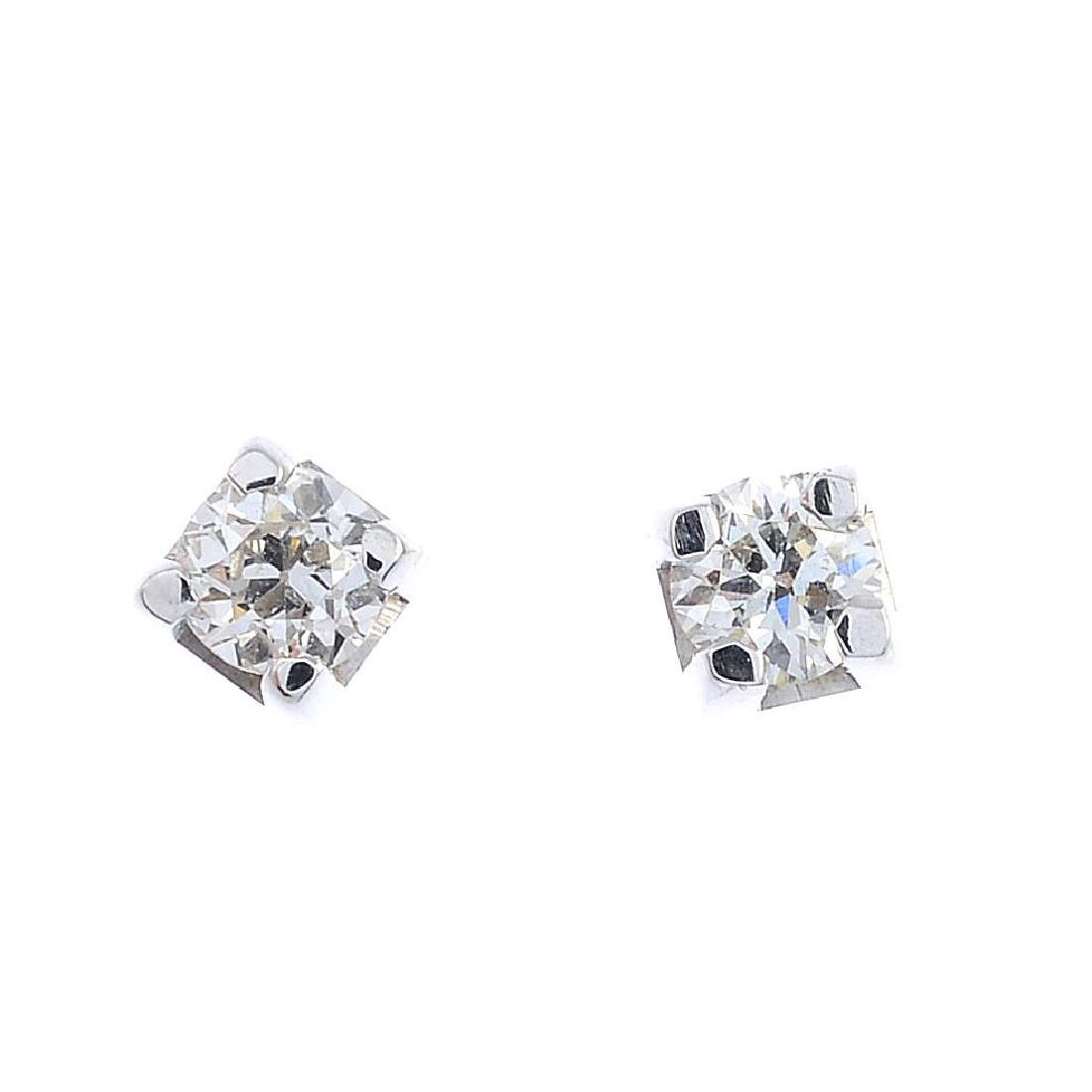 A pair of 18ct gold brilliant-cut diamond stud