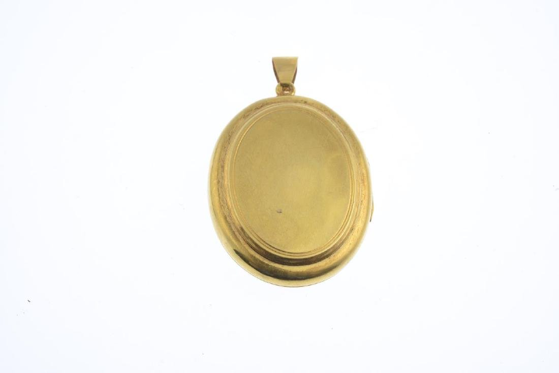 A mid Victorian gold split pearl and enamel locket. The - 2