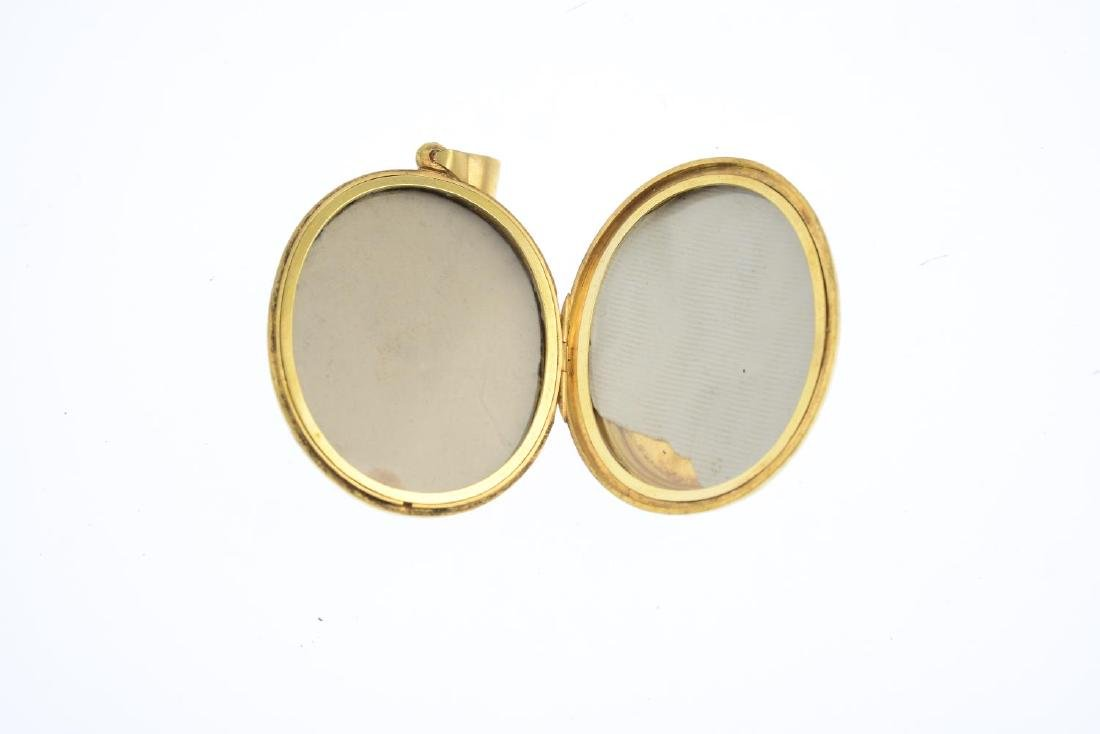 A mid Victorian gold split pearl and enamel locket. The - 3