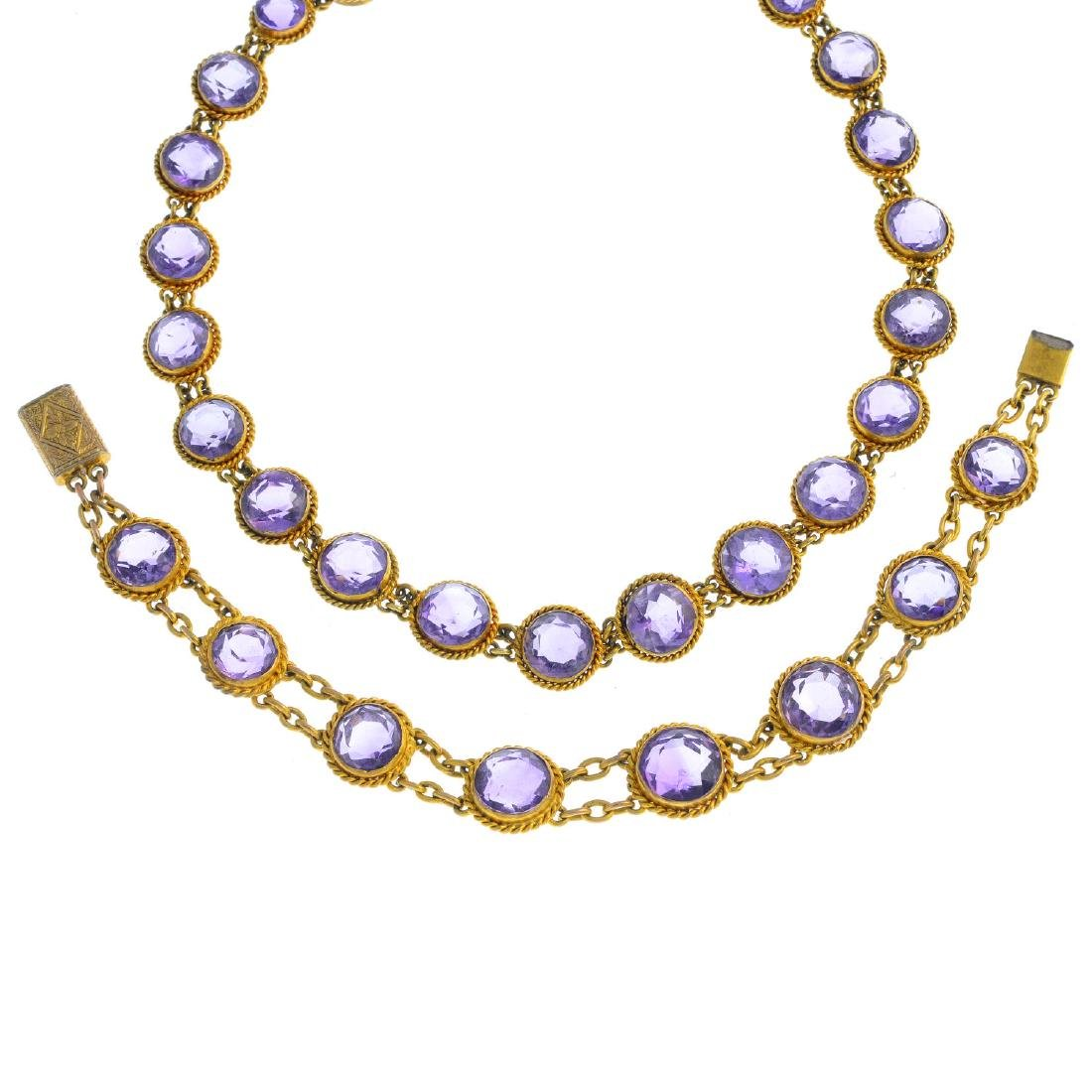 An amethyst necklace and bracelet and spare links. The
