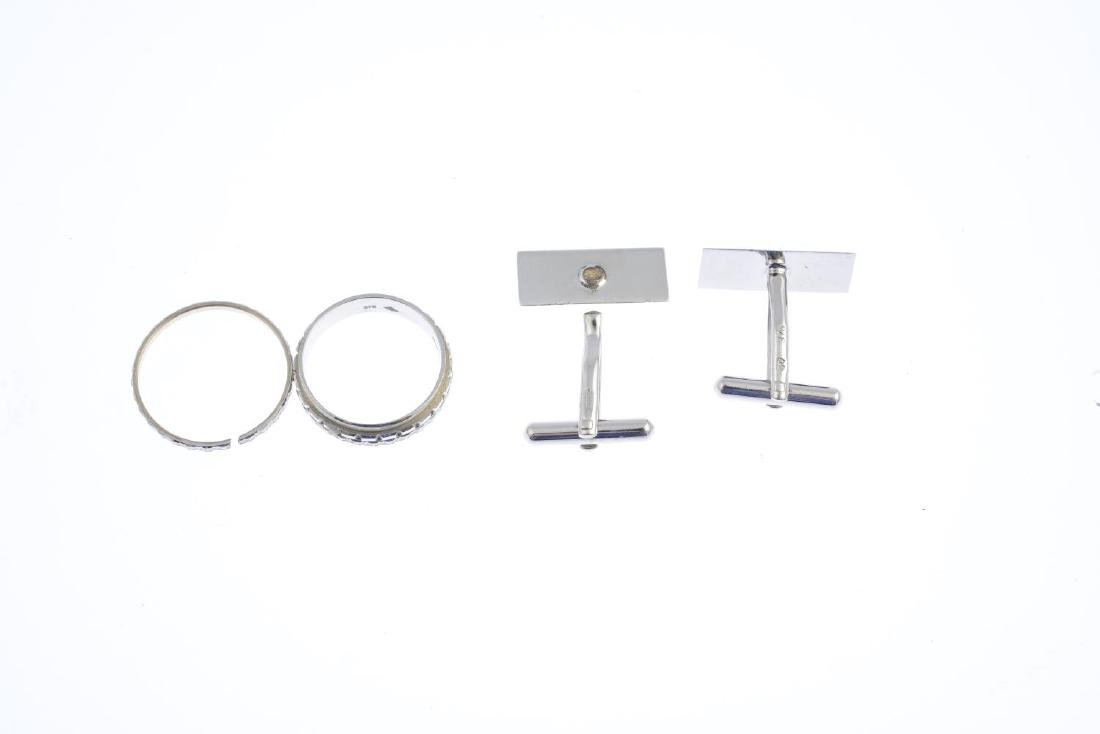 A pair of 9ct gold cufflinks and a ring. The cufflinks - 3