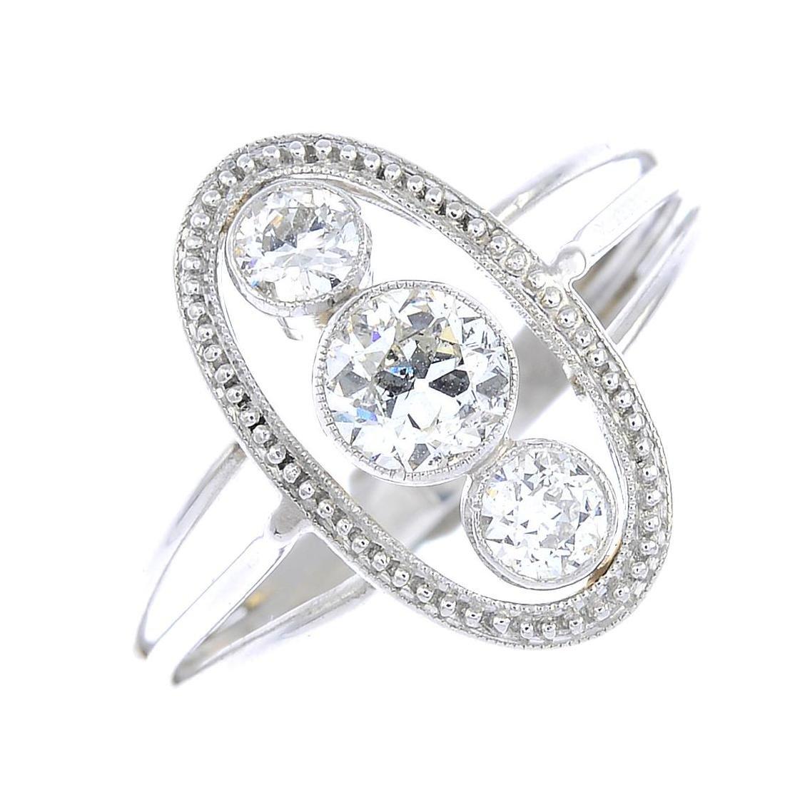 A diamond dress ring. Of openwork design, the graduated