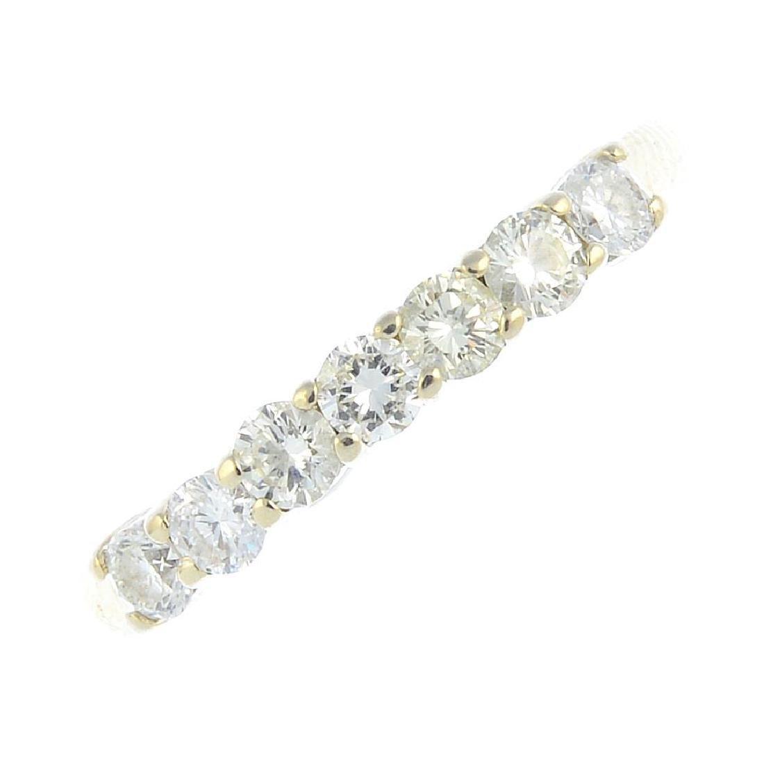 A 14ct gold diamond seven-stone ring. The brilliant-cut