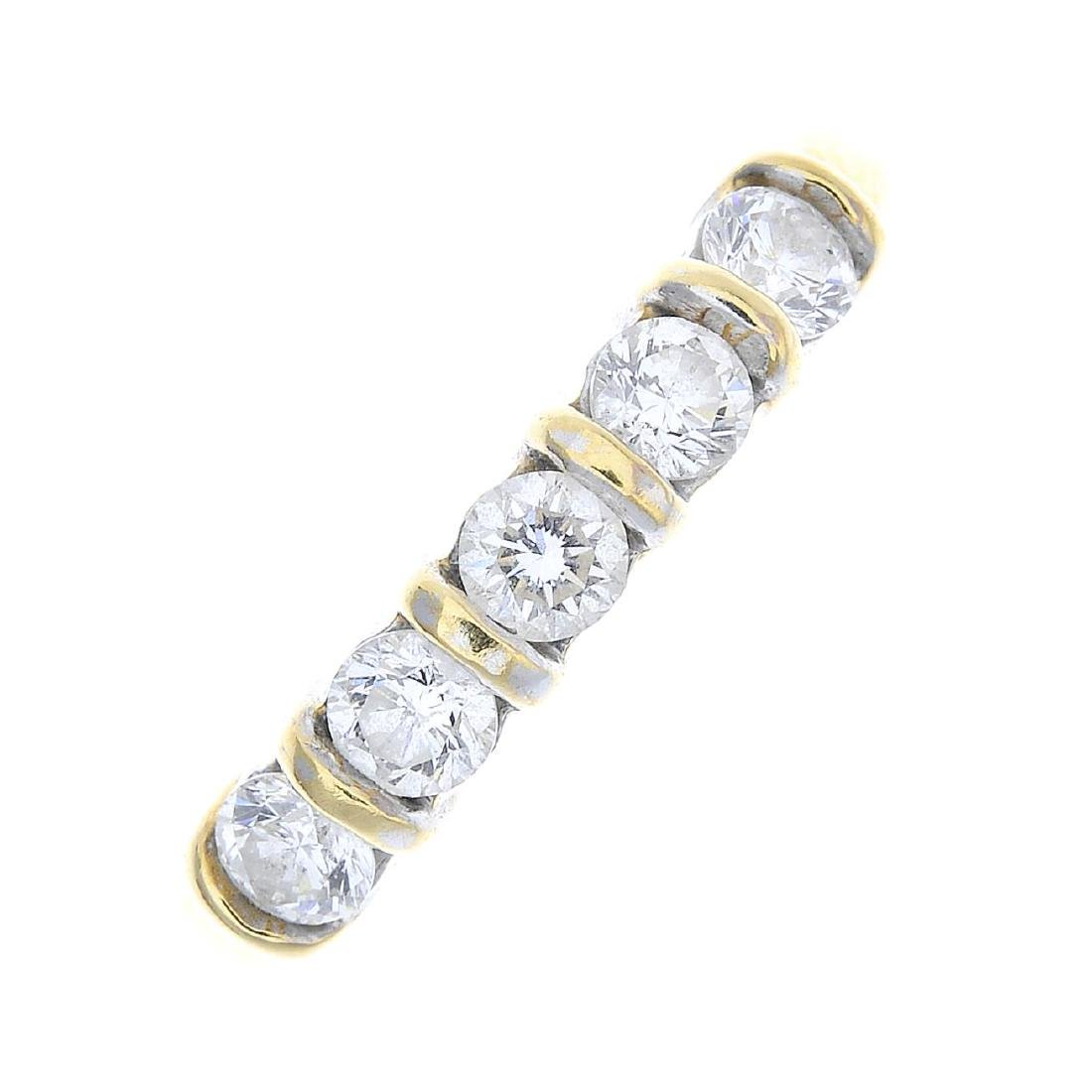An 18ct gold diamond five-stone ring. Designed as a