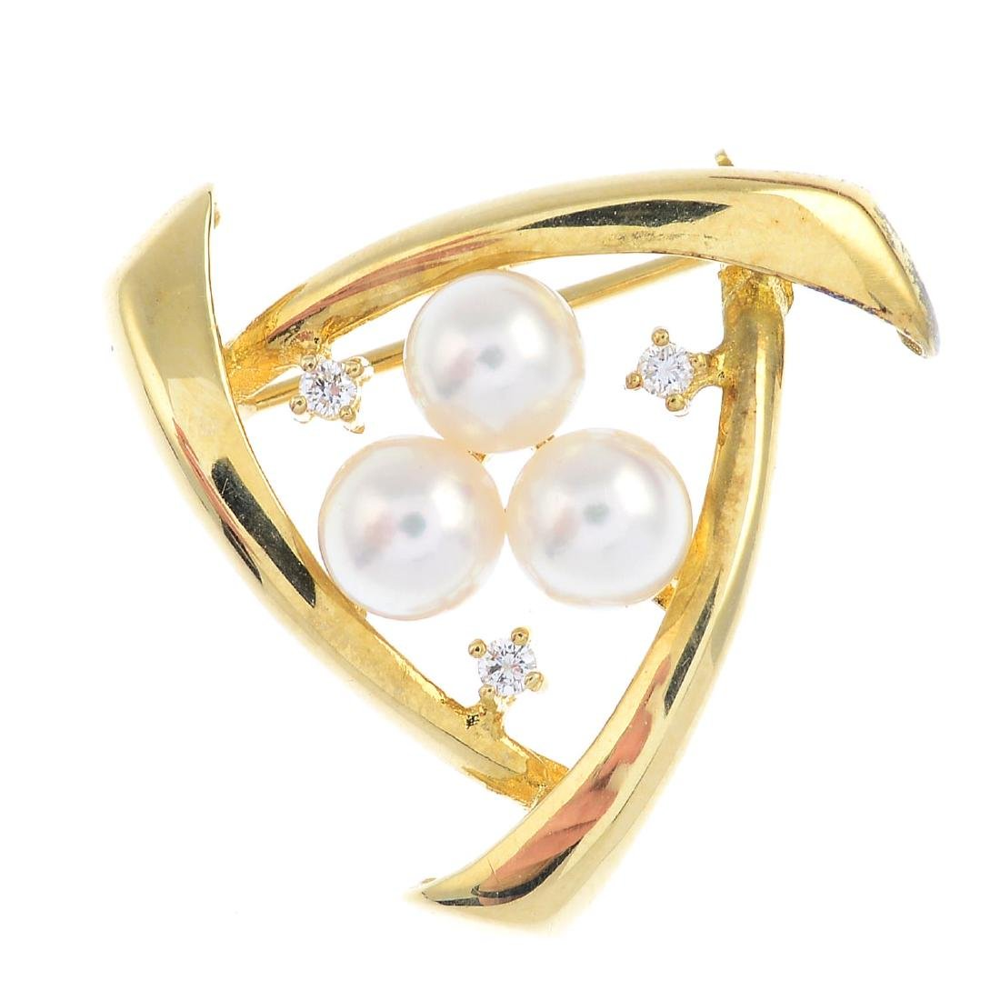 A cultured pearl and diamond brooch. The cultured pearl