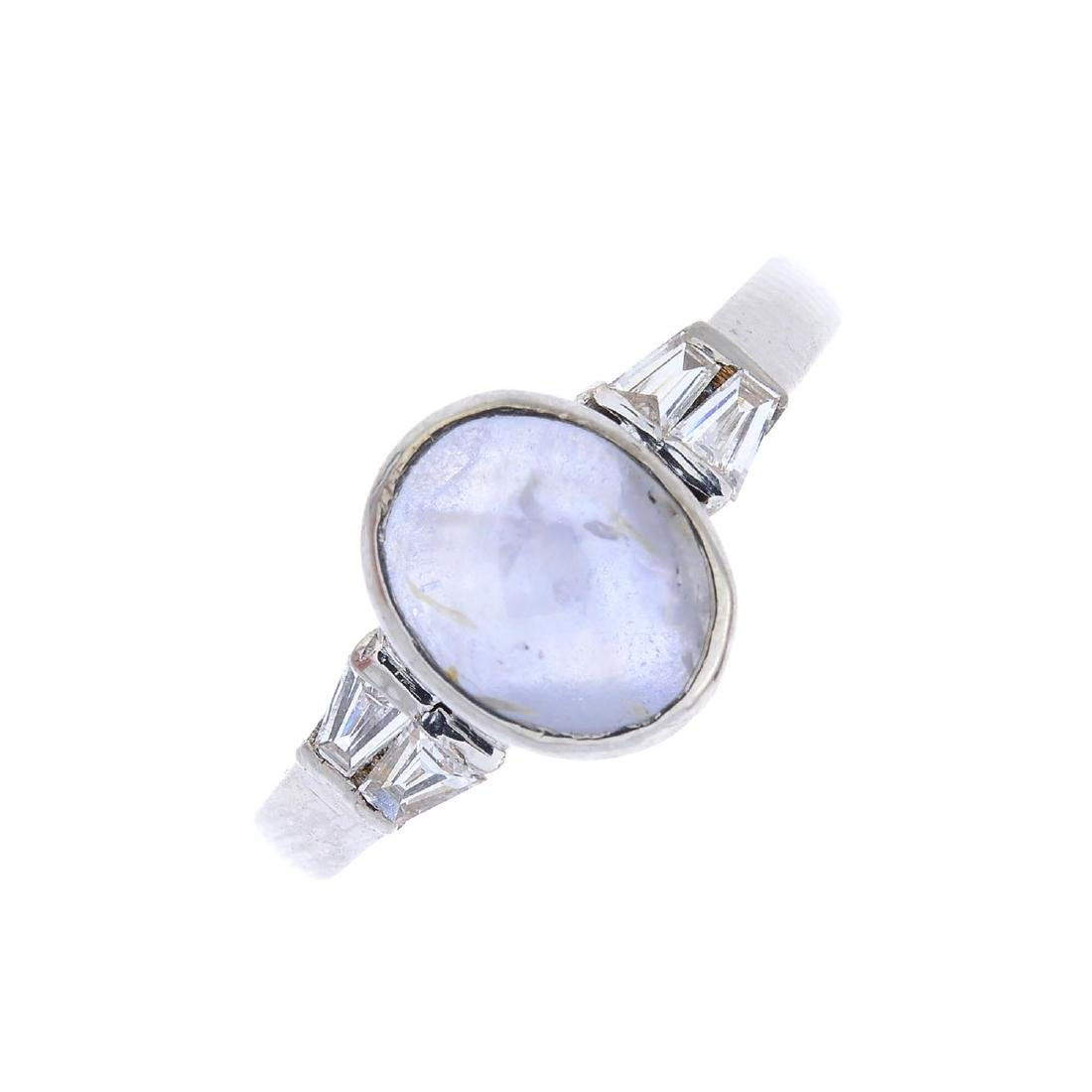 A star sapphire and diamond dress ring. The oval star
