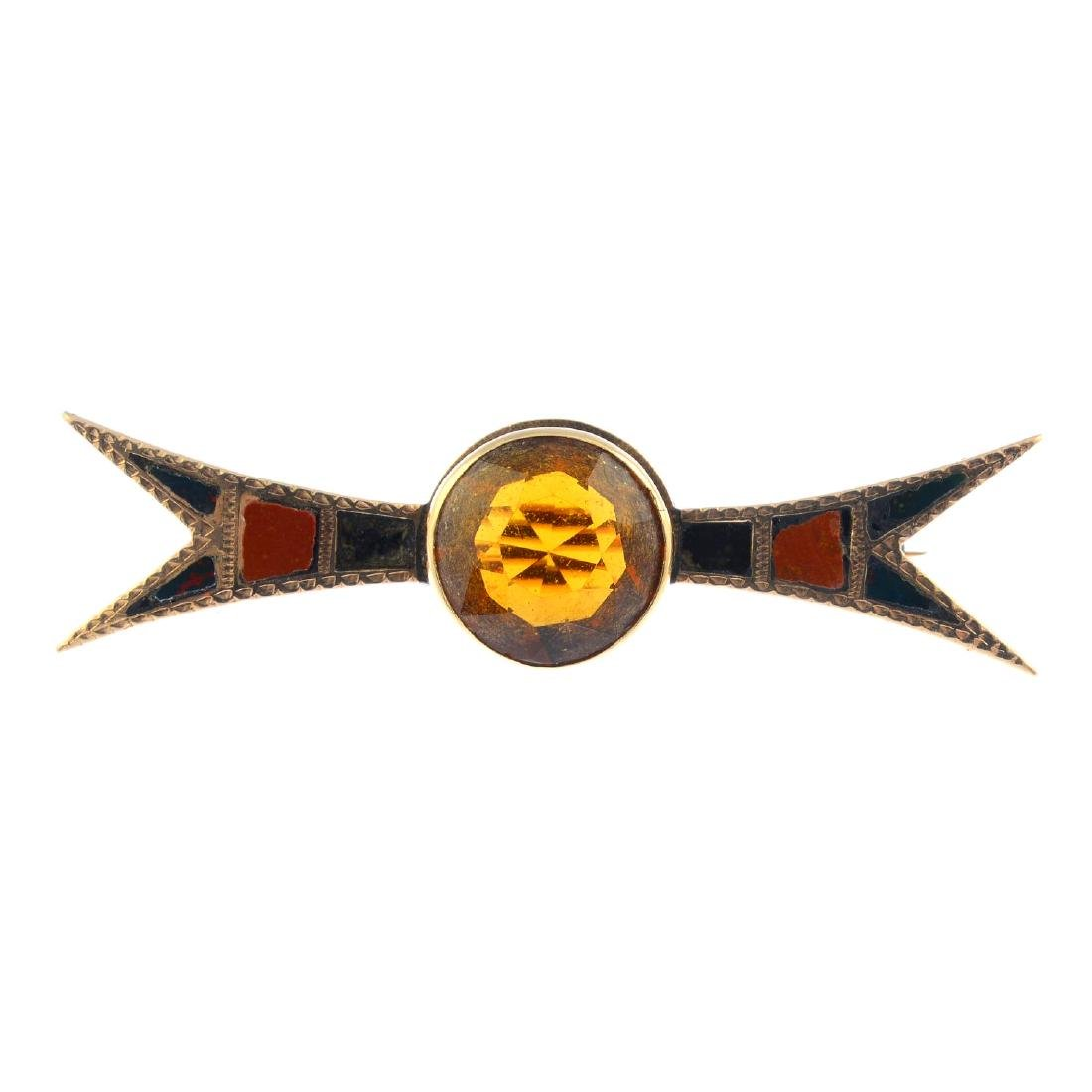 A citrine and hardstone brooch. The circular-shape