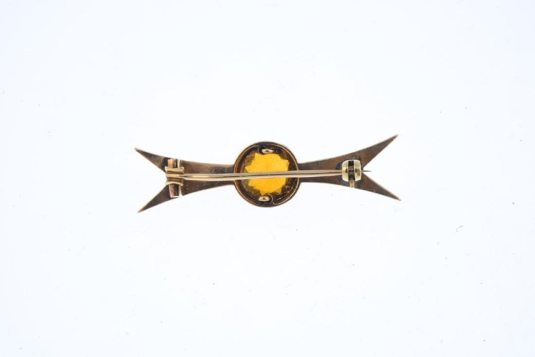 A citrine and hardstone brooch. The circular-shape - 2