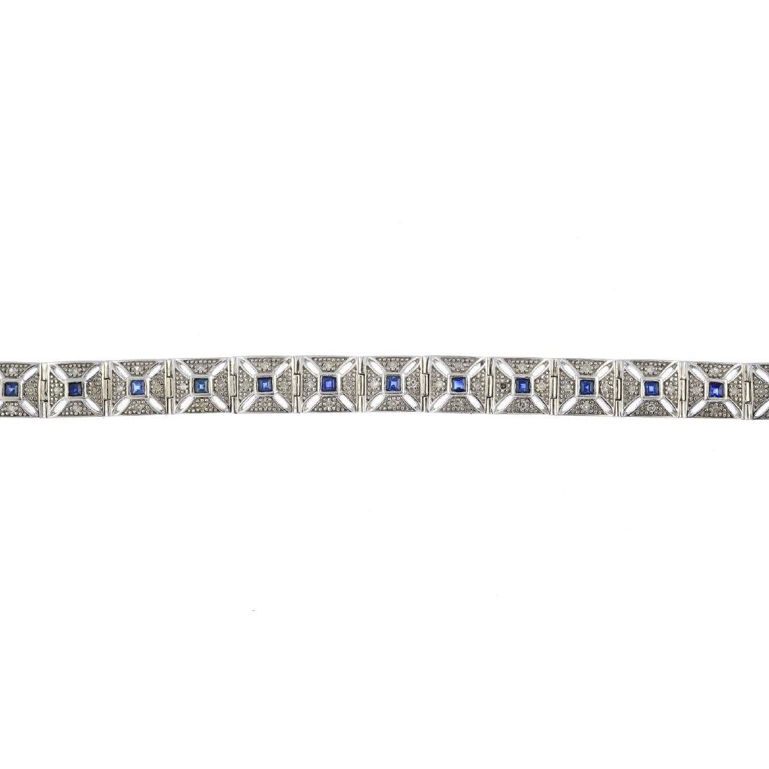 A diamond and sapphire bracelet. Designed as a series