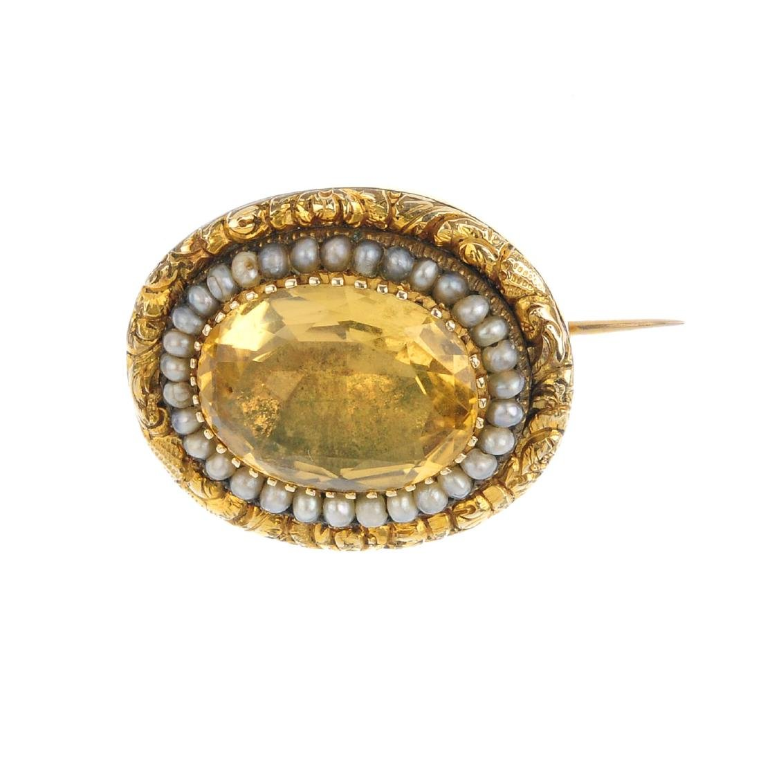 A late Victorian citrine and split pearl brooch. The