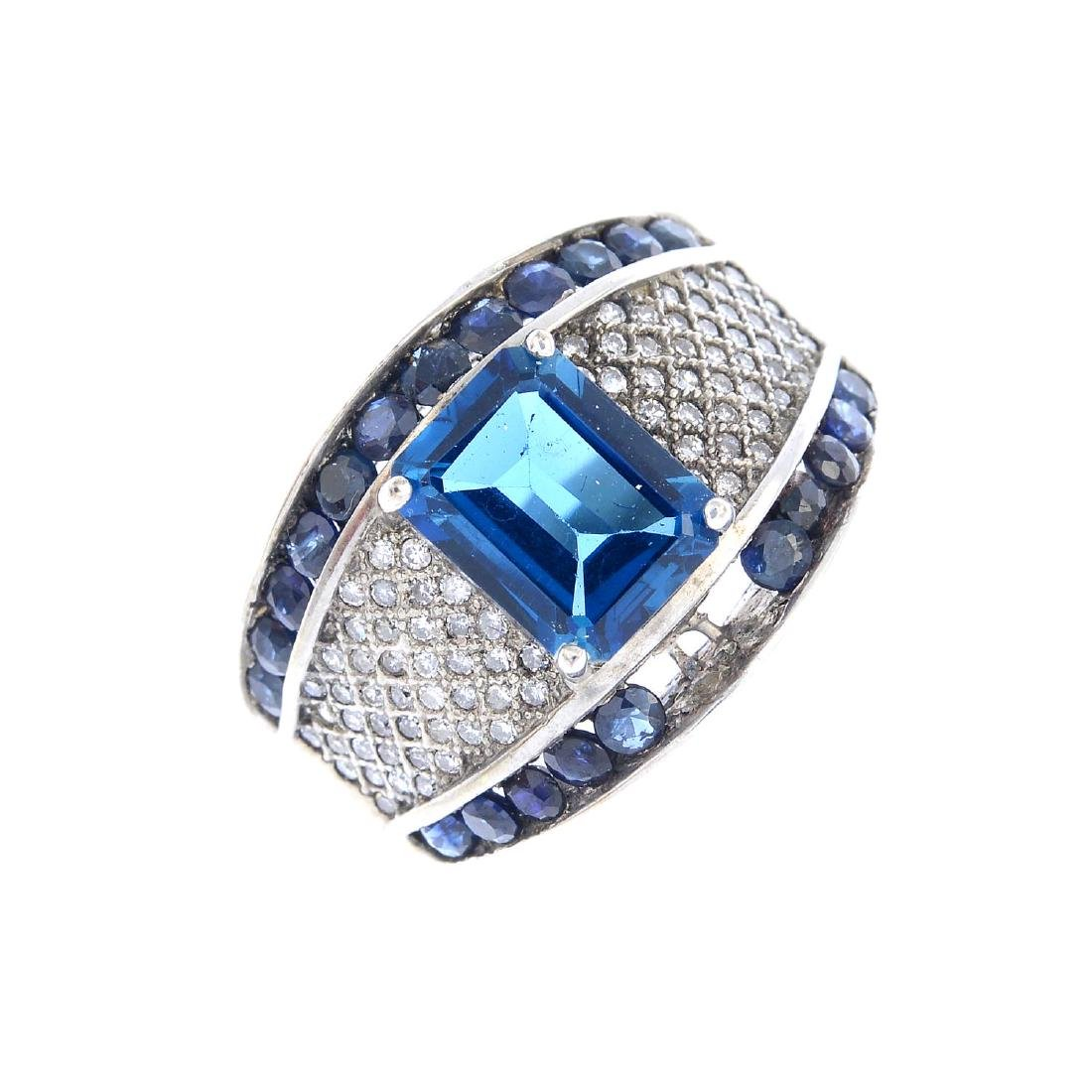 A topaz, sapphire and diamond dress ring. The