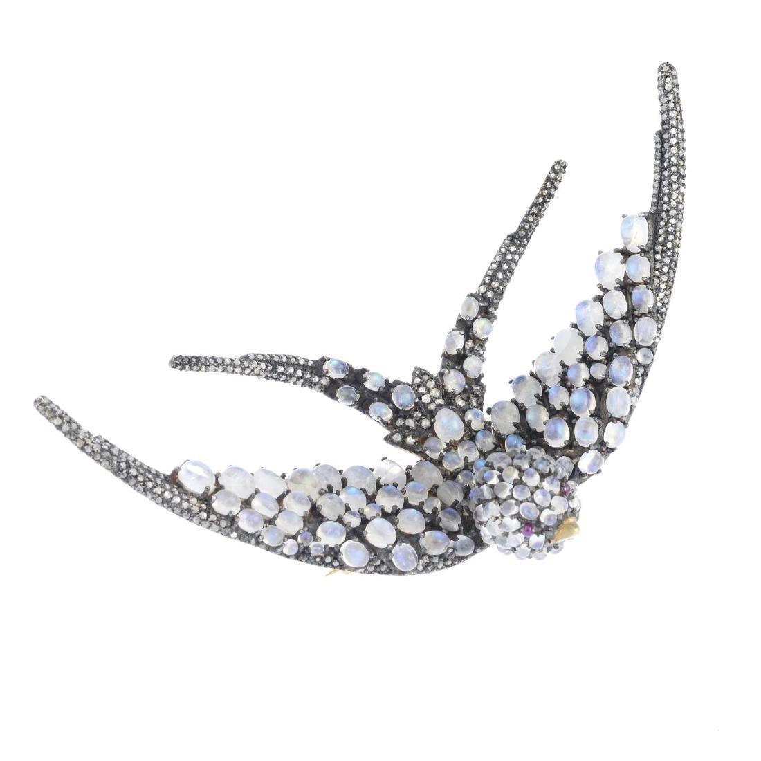 A gem-set brooch. Designed as a swallow, set throughout