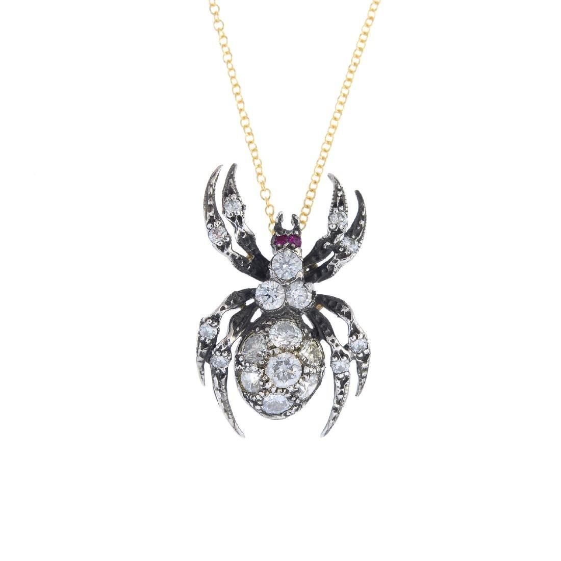 A diamond and ruby spider pendant. The pave-set diamond