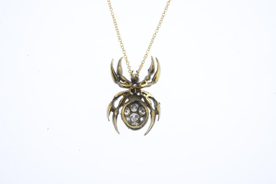 A diamond and ruby spider pendant. The pave-set diamond - 2