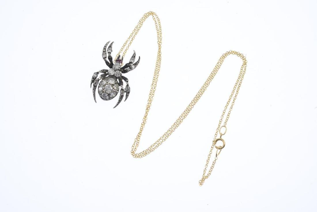 A diamond and ruby spider pendant. The pave-set diamond - 3