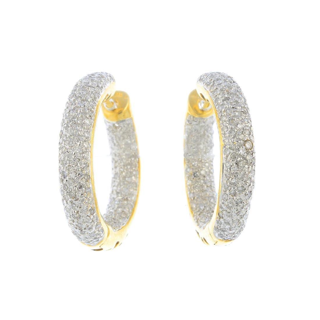 (205944) A pair of diamond hoop earrings. Each of