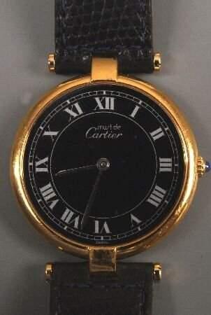MUST DE CARTIER - a gentleman's gold plated round