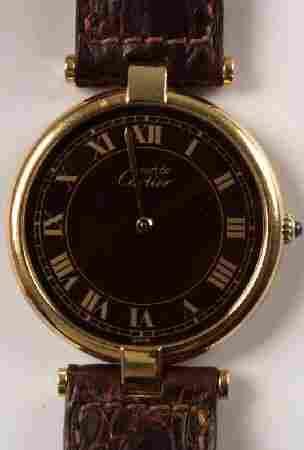 CARTIER - gentleman's silver gilt circular watch