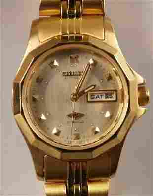CITIZEN gold plated ladies wristwatch with day an