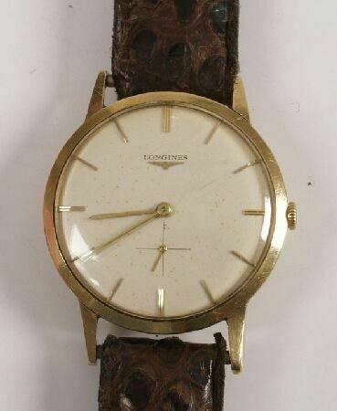 1015: LONGINES - a gentleman's 18ct yellow gold round w