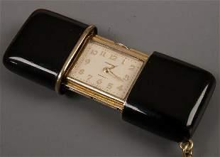 MOVADO - a ladies silver gilt purse watch the bla