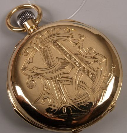 1265: 18k gold Swiss full hunter pocket watch with quar
