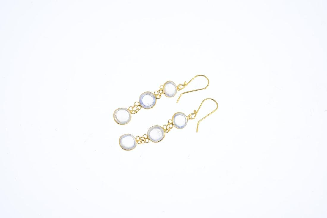 A pair of moonstone earrings. Each designed as an oval - 2