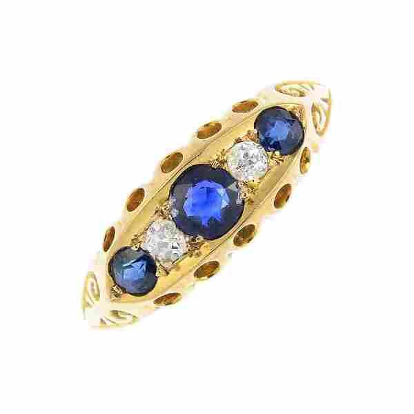 An Edwardian 18ct gold sapphire and diamond five-stone