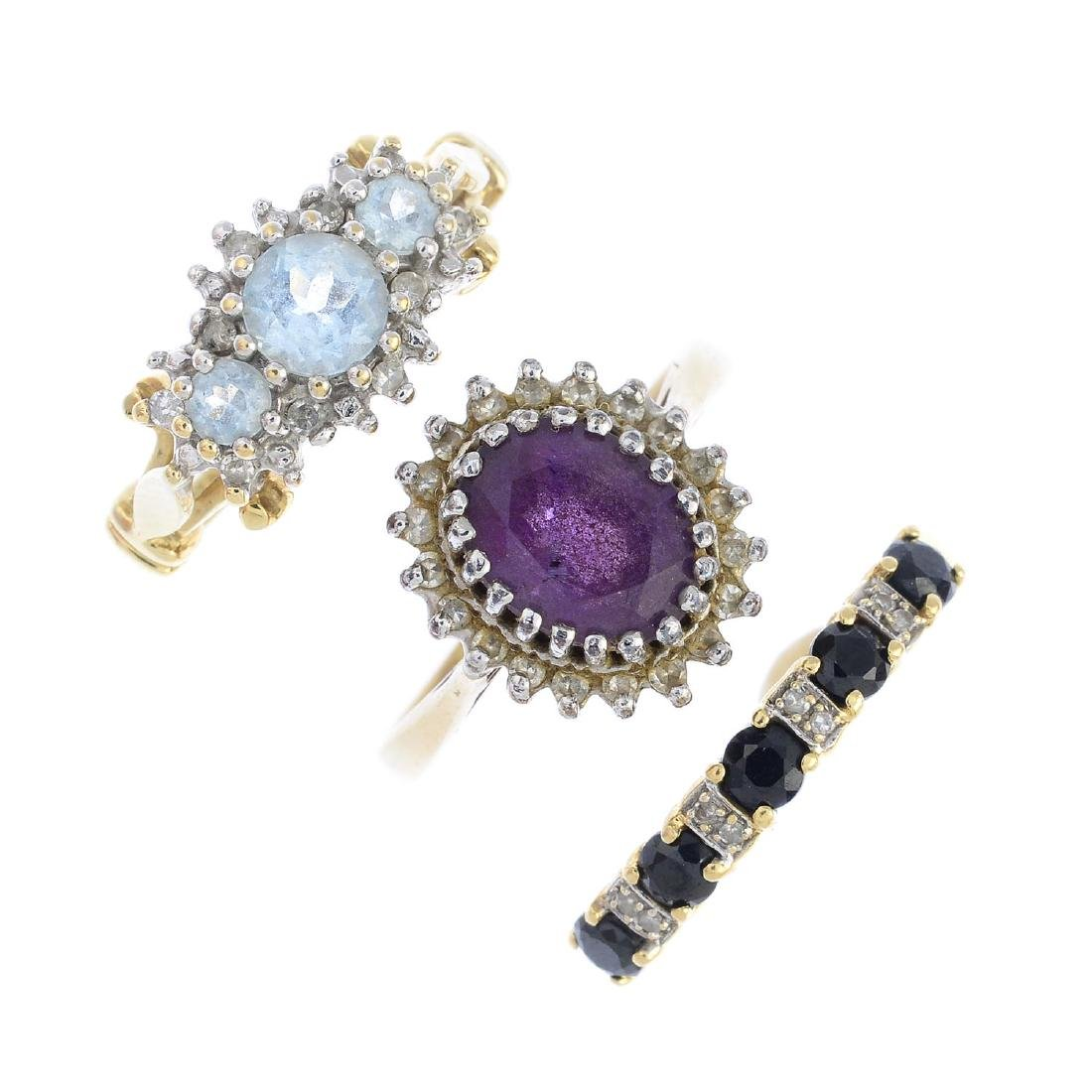 A selection of four diamond and gem-set dress rings. To