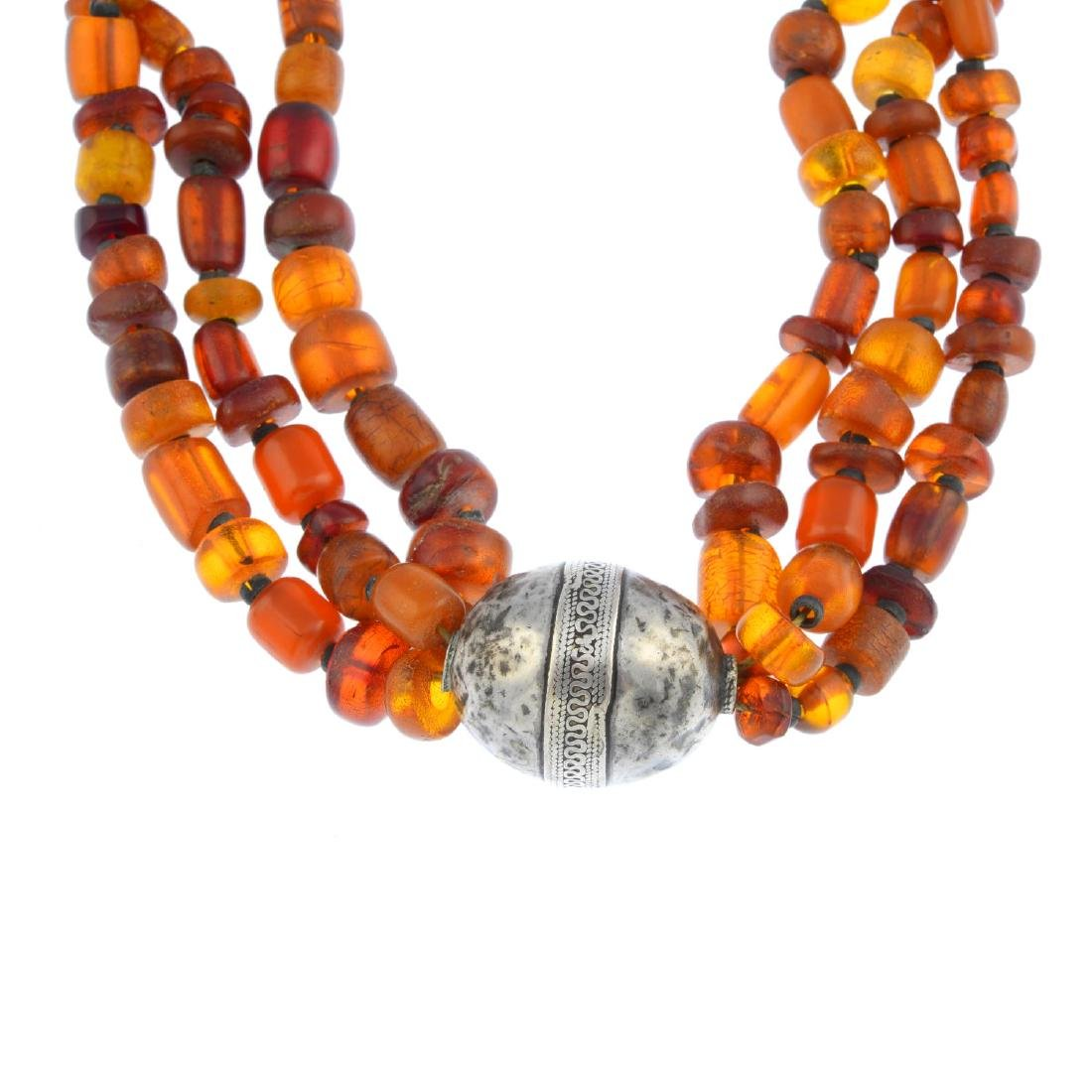 An amber necklace. Comprising a series of vari-shape