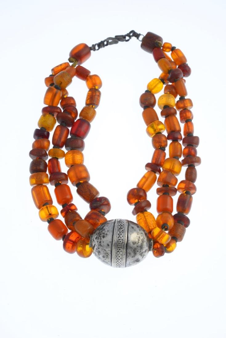 An amber necklace. Comprising a series of vari-shape - 3