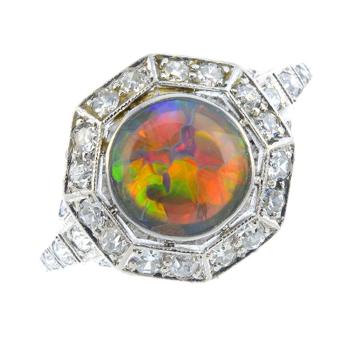 An Art Deco platinum opal and diamond cluster ring. The