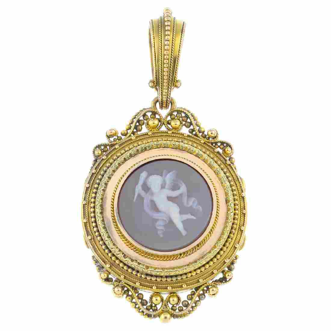 A mid Victorian gold agate cameo pendant. The sardonyx