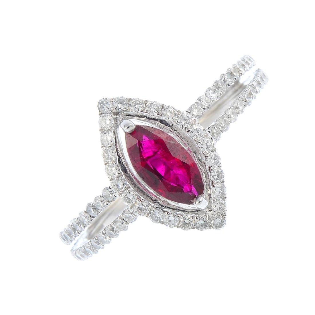 A ruby and diamond dress ring. The marquise-shape ruby,