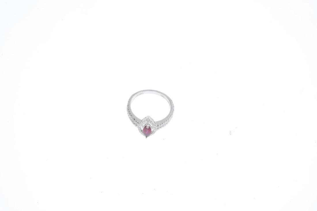A ruby and diamond dress ring. The marquise-shape ruby, - 3