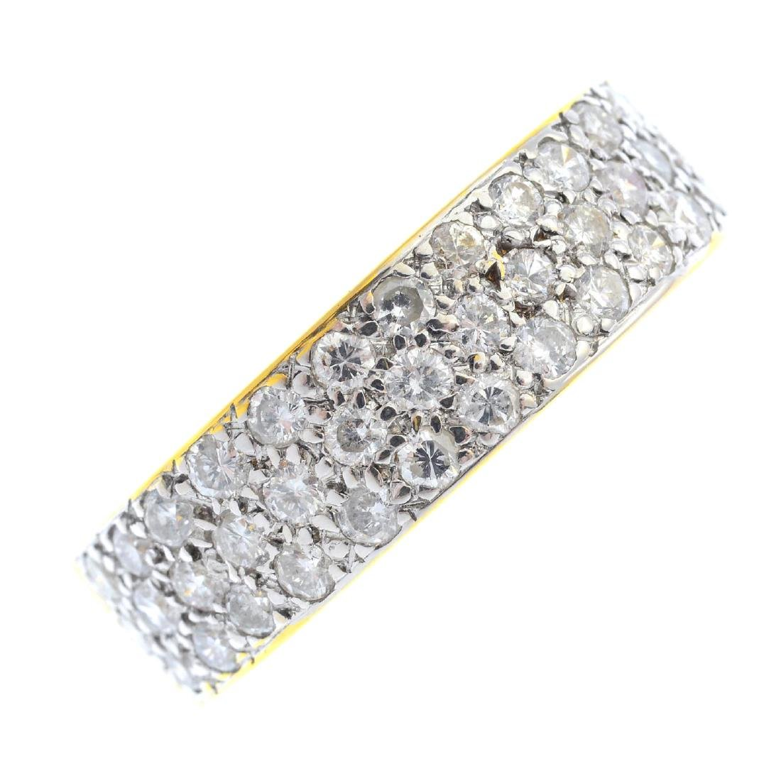 An 18ct gold diamond band ring. Designed as a pave-set