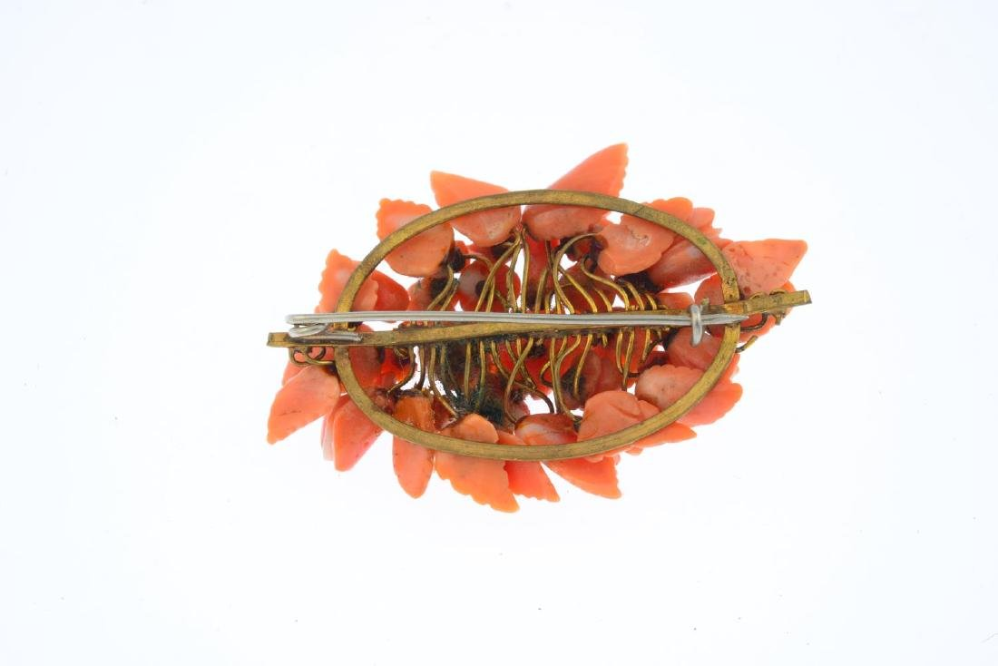 A coral brooch. Of marquise outline, the carved coral - 2