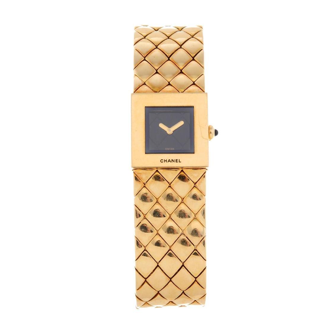 CHANEL - a lady's Matelassé bracelet watch. 18ct yellow