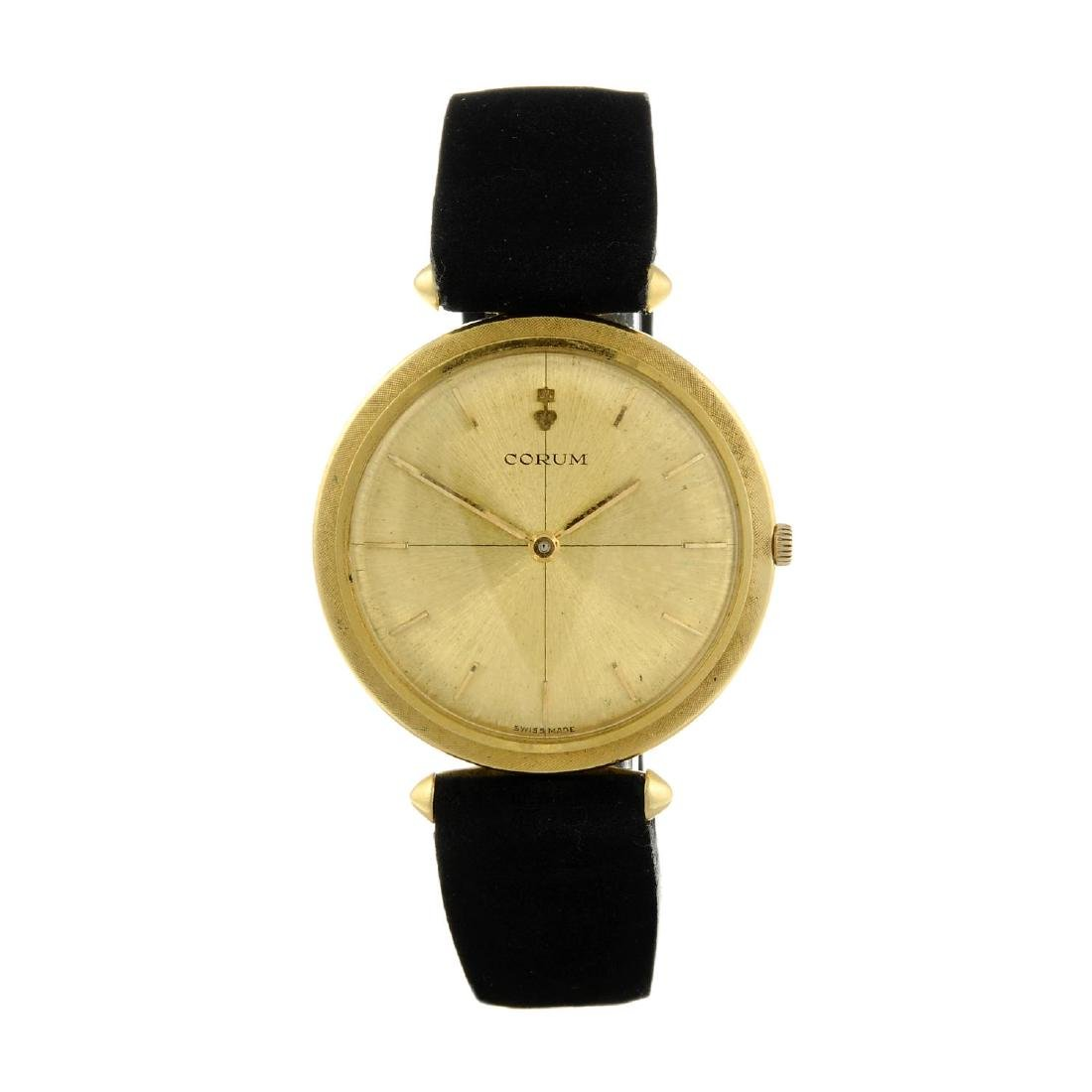 CORUM - a gentleman's wrist watch. Yellow metal case,