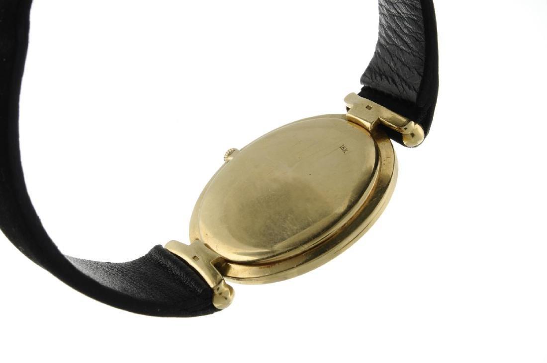 CORUM - a gentleman's wrist watch. Yellow metal case, - 2