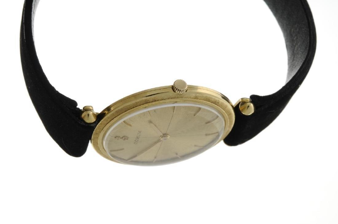 CORUM - a gentleman's wrist watch. Yellow metal case, - 3