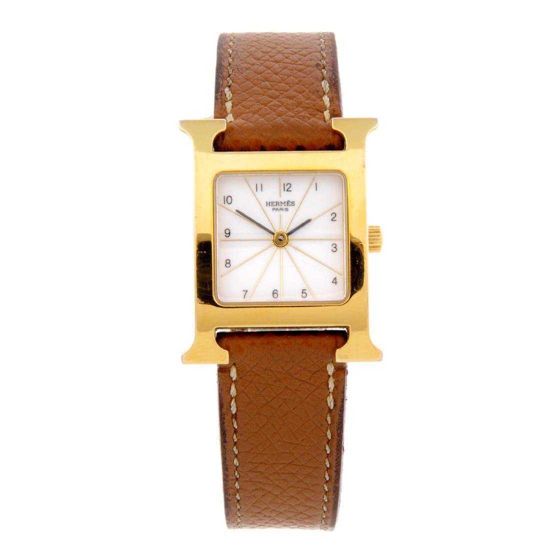 HERMÈS - a lady's Heure H wrist watch. Gold plated
