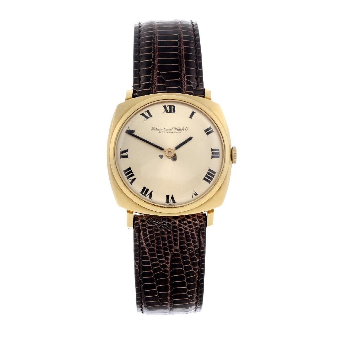 IWC - a gentleman's wrist watch. Yellow metal case,