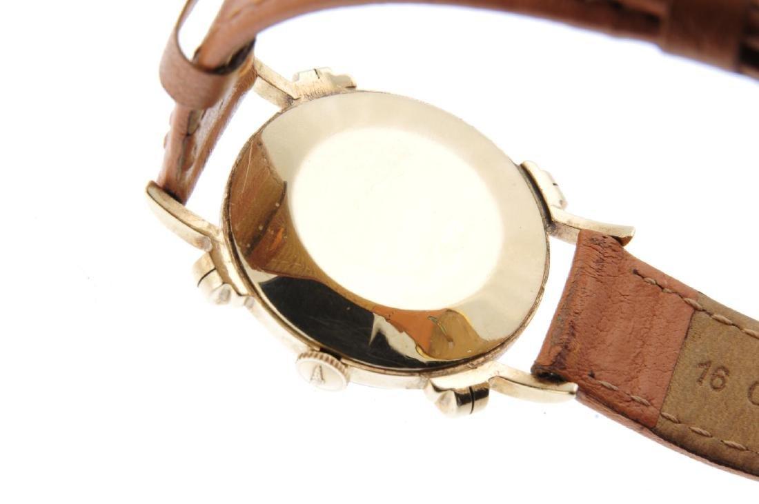 LONGINES - a gentleman's wrist watch. Yellow metal - 3