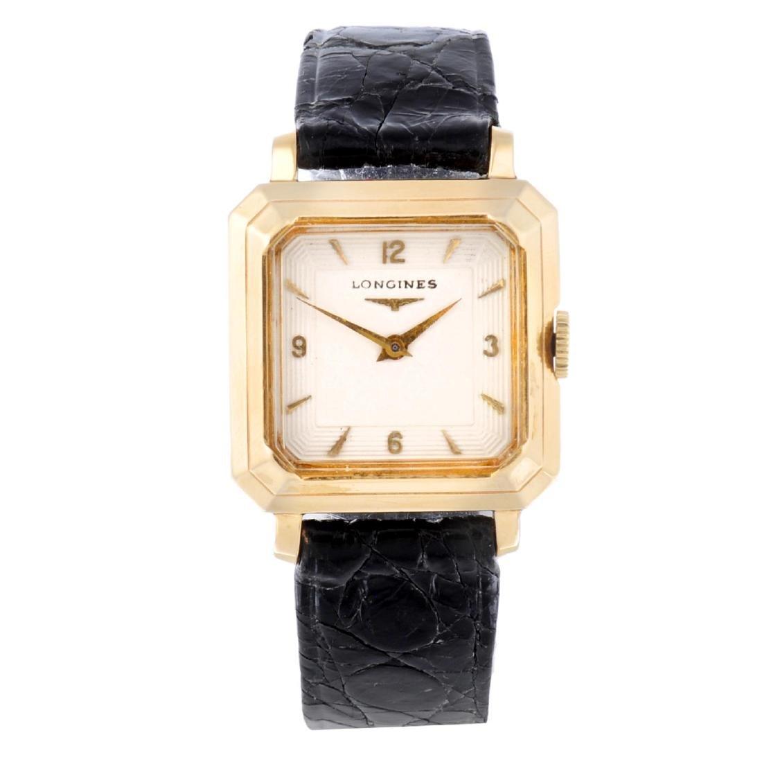 LONGINES - a gentleman's wrist watch. Yellow metal