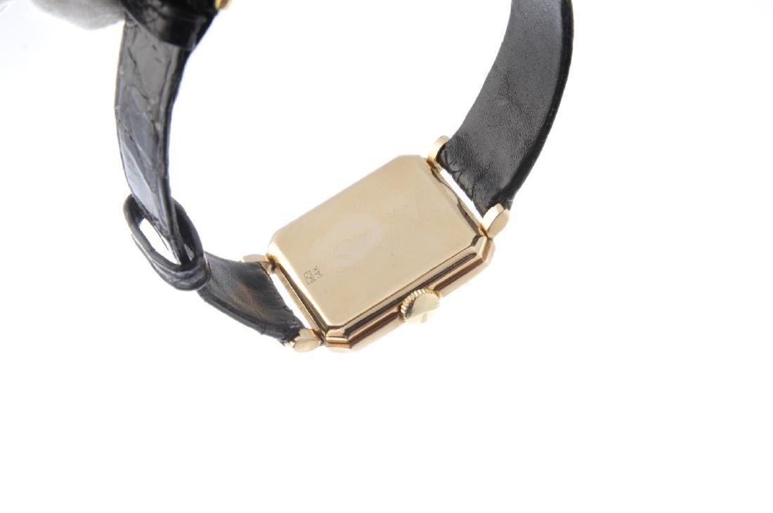 LONGINES - a gentleman's wrist watch. Yellow metal - 2