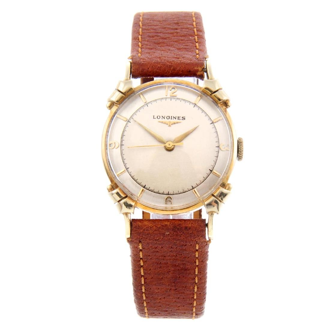LONGINES - a gentleman's wrist watch. Yellow metal