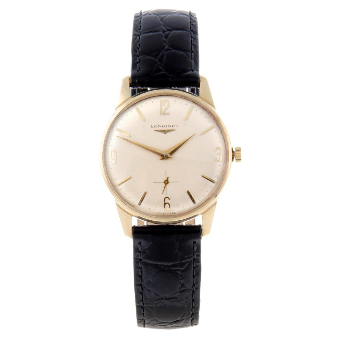 LONGINES - a gentleman's wrist watch. 9ct yellow gold