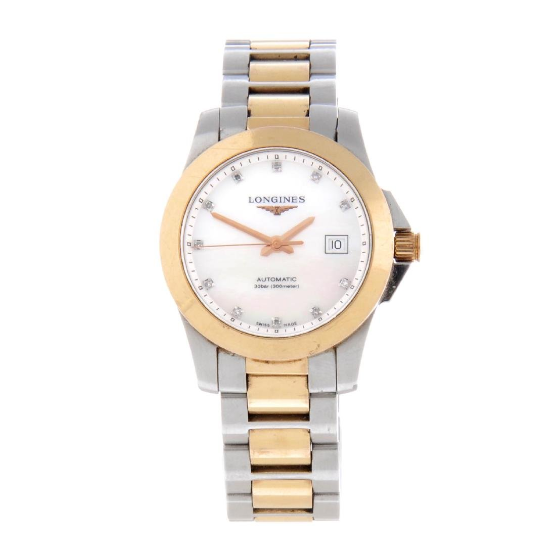 LONGINES - a lady's Conquest bracelet watch. Stainless