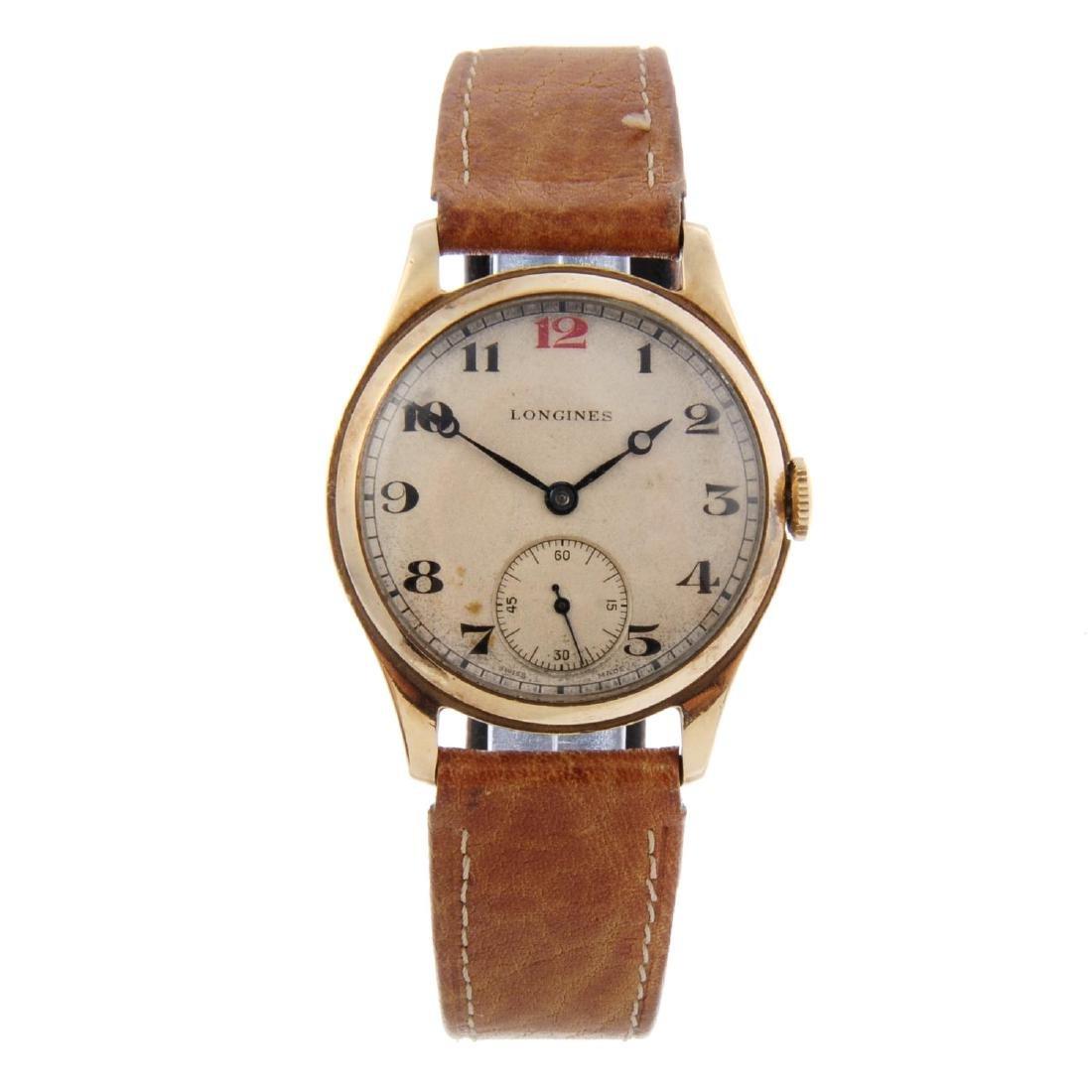 LONGINES - a gentleman's wrist watch. 9ct yellow gold